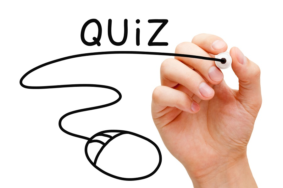 Hand sketching online Quiz concept with black marker on transparent wipe board.