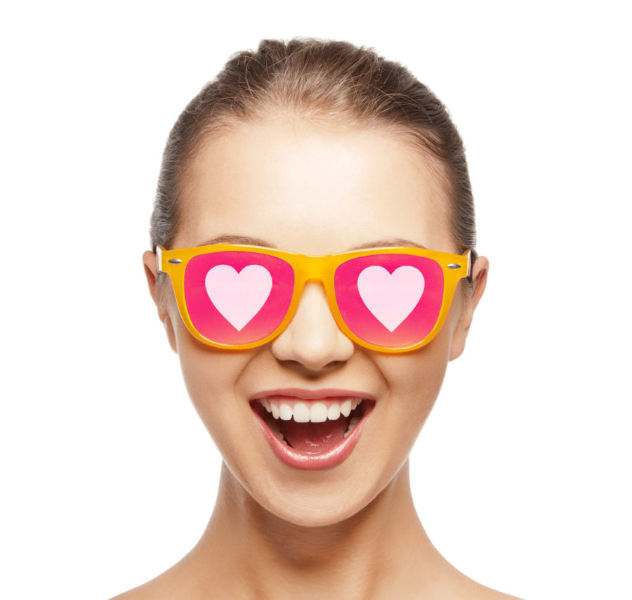 love, happiness and people concept - portrait of happy teenage girl in shades with hearts
